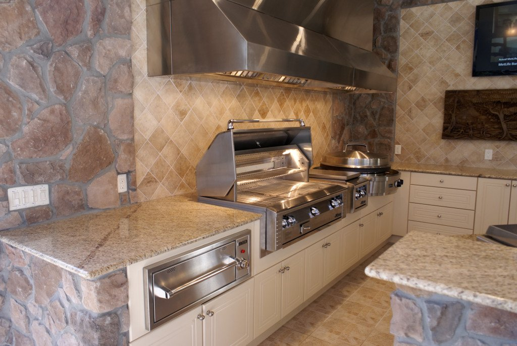 After the cabinets are installed, grills, appliances, countertops and other finishing details are added, creating a complete & functional outdoor kitchen.