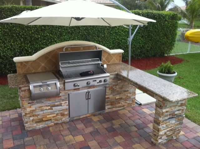 outdoor kitchen build with umbrella